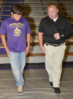 A CHS student undergoes a field sobriety test with Commercial Vehicle Enforcement Officer Jason Morris.
