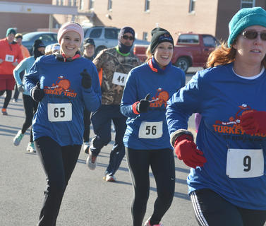 Ann Marie Pavy, at left, and Katie Irwin smile as they start the race. At right is Becky Schmidt.