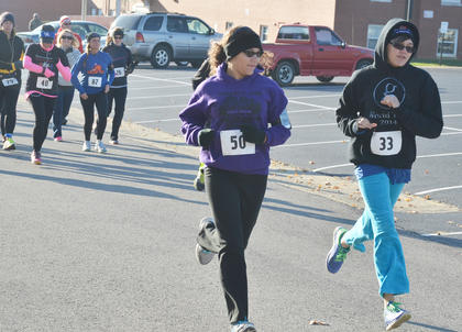 """Taliyah Hazelwood, at left, and Alexandria Carmer take off at the word """"go."""""""