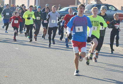 Will Ballard, in front, takes an early lead in the race. He finished first in a little more than 18 minutes.