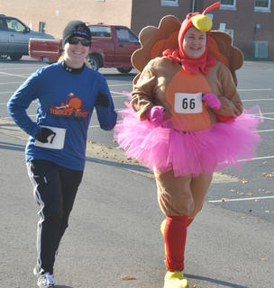 Jilly Bruns, at left, and Charity Powell, jog at the start of the race.