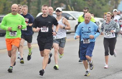 Runners get a lead on their competition during Saturday's race. From left are Les Chadwick, Marc Brock, Chris Ambers and Ellie McKinley.