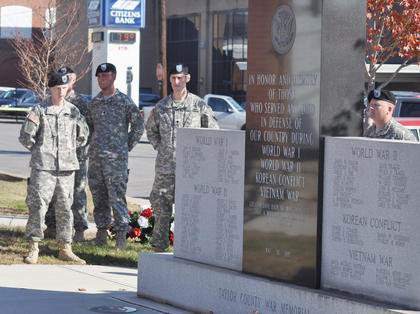 Members of the Kentucky National Guard surround the Taylor County War Memorial.