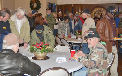 Veterans talk to one another at the reception.