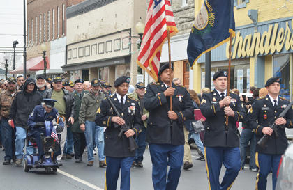 Color guard members lead the parade.