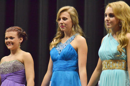 From left, Tori Cochran, Kassie Miller and Savannah Nolley hold hands as they await the winners to be announced. Miller was named the 2015 Taylor County Distinguished Young Woman and also took home the scholastic, self-expression and interview awards.