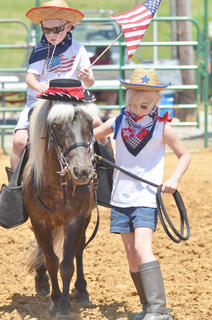 Jacob and Hannah Marcum dress in the costume class at the fair's youth horse show on Saturday.