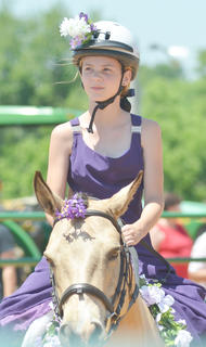 McKenzie Cook of Campbellsville residents Sugar Express in the costume class at the fair's youth horse show on Saturday.