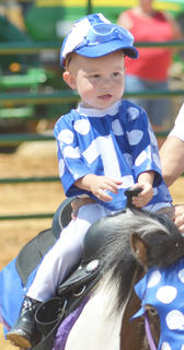 Ty Roution of Campbellsville rides on Marty as he participates in the youth horse show on Saturday.