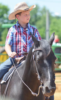 Chase Morris of Campbellsville rides Two Socks in the youth horse show at the fair on Saturday.