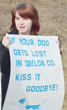 "<div class=""source"">Calen McKinney</div><div class=""image-desc"">Amber Bolin of Campbellsville holds a sign.</div><div class=""buy-pic""><a href=""http://web2.lcni5.com/cgi-bin/c2newbuyphoto.cgi?pub=085&orig=Shelter%2BProtest%2B%25232%2B7.jpg"" target=""_new"">Buy this photo</a></div>"