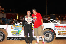"<div class=""source"">Roger Petty</div><div class=""image-desc"">Tim Tungate, with car-owner Logan Parrott, led the entire distance to capture the Super Late Model feature at Lake Cumberland Speedway on Saturday night. It was Tungate's third consecutive triumph at the Burnside track.</div><div class=""buy-pic""></div>"