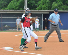 "<div class=""source"">photo/JOSH CLAYWELL</div><div class=""image-desc"">Taylor County's Addie Westbrook rounds first base after hitting a single in Monday's game against Green County in the 5th Region Softball Tournament quarterfinals at Marion County.</div><div class=""buy-pic""><a href=""/photo_select/67069"">Buy this photo</a></div>"