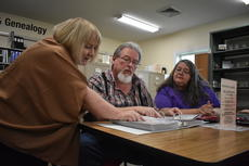 """<div class=""""source"""">photo/JOHN OVERBY</div><div class=""""image-desc"""">From left, Taylor Regional Archive Center volunteers Virginia Graves, Mike Watson and Laura Gupton look through some of the documents available at the facility.</div><div class=""""buy-pic""""><a href=""""/photo_select/69613"""">Buy this photo</a></div>"""