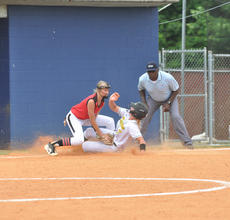 "<div class=""source"">photo/JOSH CLAYWELL</div><div class=""image-desc"">Green County's Abigail Keltner slides into third base just ahead of the tag of Taylor County's Avery Smith on Monday.</div><div class=""buy-pic""><a href=""/photo_select/67071"">Buy this photo</a></div>"