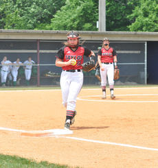 "<div class=""source"">photo/JOSH CLAYWELL</div><div class=""image-desc"">Taylor County's Sarah Botkin touches first base after fielding a ground ball against Marion County on Monday.</div><div class=""buy-pic""><a href=""/photo_select/67073"">Buy this photo</a></div>"