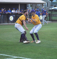 """<div class=""""source"""">photo/JOSH CLAYWELL</div><div class=""""image-desc"""">Campbellsville's Lane Bottoms, left, and Arren Hash celebrate after the Eagles recorded the final out against Adair County.</div><div class=""""buy-pic""""><a href=""""/photo_select/67006"""">Buy this photo</a></div>"""