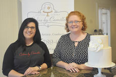 "<div class=""source"">Photo/ZAC OAKES</div><div class=""image-desc"">Shanon Camille O'Banion, left, and Andrea Harmon from Cakes by Camille on East Main Street in Campbellsville will be featured in an episode of the Food Network program ""Winner Cake All."" The episode featuring O'Banion and Harmon is scheduled to premier Monday night at 10 p.m. on the Food Network.</div><div class=""buy-pic""><a href=""/photo_select/68488"">Buy this photo</a></div>"