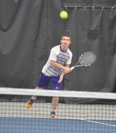 """<div class=""""source"""">photo/JOSH CLAYWELL</div><div class=""""image-desc"""">Campbellsville's Cass Kidwell hits a forehand shot as he and doubles partner Cody Davis play Corbin in a first-round match Thursday.</div><div class=""""buy-pic""""><a href=""""/photo_select/67029"""">Buy this photo</a></div>"""