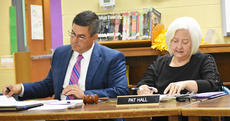 "<div class=""source"">Photo/Zac Oakes</div><div class=""image-desc"">Superintendent Kirby Smith, left, and Board Chair Pat Hall look over and discuss the working budget presented to the board Monday night by CIS Finance Director Chris Kidwell.</div><div class=""buy-pic""><a href=""/photo_select/67721"">Buy this photo</a></div>"