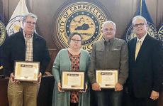 """<div class=""""source"""">Cody Wood</div><div class=""""image-desc"""">Campbellsville Mayor Tony Young presented plaques to city council members who completed city government training. From left are Greg Rice, Diane Ford-Benningfield and Allen Johnson.</div><div class=""""buy-pic""""><a href=""""/photo_select/66264"""">Buy this photo</a></div>"""