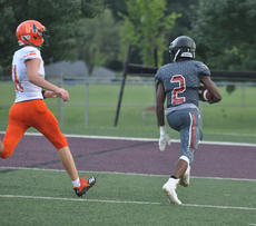 """<div class=""""source"""">photo/JOSH CLAYWELL</div><div class=""""image-desc"""">Taylor County&#039;s DeJhon Irvin, right, outruns a Hart County defender to the end zone Friday night.</div><div class=""""buy-pic""""><a href=""""/photo_select/67544"""">Buy this photo</a></div>"""