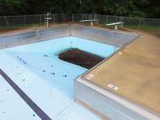 "<div class=""source"">Jeff Moreland</div><div class=""image-desc"">The Campbellsville city swimming pool is empty, and will remain closed for the second consecutive summer due to needed repairs, which have been reported to carry a price tag of more than $200,000. According to information provided to city council members Monday night, the pool already loses approximately $25,000 each year, and the investment to make repairs would make that amount even greater.</div><div class=""buy-pic""></div>"