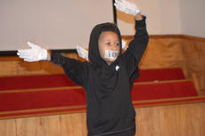 "<div class=""source"">Zac Oakes</div><div class=""image-desc"">Youth at First Baptist Church performed a program for Black History Month. The youth had tape over the mouths wtih words such as ""Pray"" and ""Justice for All."" The program also focused on recent events, including the shooting death of Florida teenager Trayvon Martin.</div><div class=""buy-pic""><a href=""/photo_select/66630"">Buy this photo</a></div>"