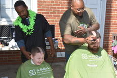 "<div class=""source"">Photo/Zac Oakes</div><div class=""image-desc"">Mason, left, and Derrick Biggers have their heads shaved by Campbellsville University School of Barbering students at the St. Baldrick's event.</div><div class=""buy-pic""><a href=""/photo_select/66912"">Buy this photo</a></div>"