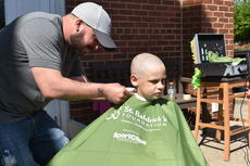 "<div class=""source"">Photo/Zac Oakes</div><div class=""image-desc"">Eight-year-old Calvin Goodwin has his head shaved. Calvin is a student at Taylor County Elementary School. He has a classmate who is losing their hair due to cancer, and Calvin wanted to show his support.</div><div class=""buy-pic""><a href=""/photo_select/66914"">Buy this photo</a></div>"
