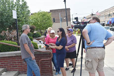 "<div class=""source"">Zac Oakes</div><div class=""image-desc"">One of several protesters outside the Taylor County Judicial Center is interviewed by a television reporter following the agreement that was reached in the animal abuse case against Bobby and Rebeccca Phillips.</div><div class=""buy-pic""><a href=""/photo_select/67579"">Buy this photo</a></div>"
