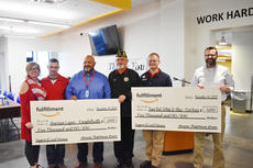 "<div class=""source"">Zac Oakes</div><div class=""image-desc"">Campbellsville's Amazon Fulfillment Center presented two checks at a recent ceremony to honor veterans. Each was valued at $5,000, with one going to Campbellsville's American Legion Post 82, and the other to Fort Knox Team Red, White & Blue. </div><div class=""buy-pic""><a href=""/photo_select/66319"">Buy this photo</a></div>"