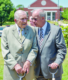 "<div class=""source"">photo/ARIEL C. EMBERTON, CU</div><div class=""image-desc"">Dr. E. Bruce Heilman, a 1948 graduate of Campbellsville Junior College, talks with Dr. Michael V. Carter, Campbellsville University president, as they get ready for the groundbreaking for the E. Bruce Heilman Welcome Center.</div><div class=""buy-pic""></div>"