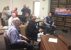 """<div class=""""source"""">Zac Oakes</div><div class=""""image-desc"""">All eyes were on the screen projecting totals at the Taylor County Courthouse Tuesday evening. Pictured, election officials, including Taylor County Clerk Mark Carney, center, back, track the results as precincts reported results.</div><div class=""""buy-pic""""><a href=""""/photo_select/68071"""">Buy this photo</a></div>"""