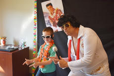 "<div class=""source"">Photo/Zac Oakes</div><div class=""image-desc"">Isaiah Litton of Campbellsville poses for a picture with an Elvis impersonator at the Taylor County Public Library's Summer Reading Kickoff Party.</div><div class=""buy-pic""><a href=""/photo_select/67129"">Buy this photo</a></div>"