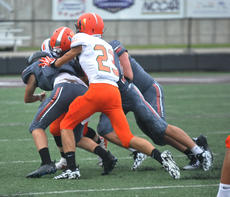 """<div class=""""source"""">photo/JOSH CLAYWELL</div><div class=""""image-desc"""">A gaggle of Cardinals tackle a Hart County ball carrier during Friday&#039;s game in the Forcht Bank Bowl at Campbellsville University.</div><div class=""""buy-pic""""><a href=""""/photo_select/67546"""">Buy this photo</a></div>"""