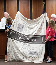 "<div class=""source"">Photo/Josh Claywell</div><div class=""image-desc"">Sherry Kerr, left, and Debbie McNear show a quilt that was presented to the family of former magistrate Ed Gorin, who stepped down last month due to health issues.</div><div class=""buy-pic""><a href=""/photo_select/67235"">Buy this photo</a></div>"