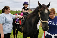 """<div class=""""source"""">Submitted</div><div class=""""image-desc"""">Sophia Newton enjoys a ride on a horse at The REATH Center in Campbellsville.</div><div class=""""buy-pic""""></div>"""