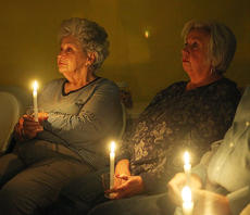 "<div class=""source"">Jeff Moreland</div><div class=""image-desc"">Viola Benaitis, left, and Beverly Pike listen during the candle-lighting service at the Central Kentucky chapter of The Compassionate Friends Sunday evening. This was the 21st annual worldwide candle-lighting service in honor of children who have passed away.</div><div class=""buy-pic""><a href=""/photo_select/66373"">Buy this photo</a></div>"