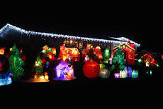 "<div class=""source"">Jeff Moreland</div><div class=""image-desc"">Pictured is one of the 53 inflatable Christmas decorations in the front yard of Jeff and Jennifer Richardson. The Richardsons live at 362 Smith Chapel Road, and they welcome people to come by their home and take a look at their inflatable decorations, which are usually inflated between 5:30 and 11:30 p.m. daily.</div><div class=""buy-pic""><a href=""/photo_select/66363"">Buy this photo</a></div>"