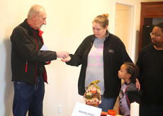 """<div class=""""source"""">Jeff Moreland</div><div class=""""image-desc"""">Dennis Brinley, construction manager for the Habitat for Humanity house recently built on Wickliffe Avenue, presents the keys to Jannifer Fisher. Fisher and her husband, Lee, along with their four daughters, moved into the home Saturday.</div><div class=""""buy-pic""""><a href=""""/photo_select/66411"""">Buy this photo</a></div>"""