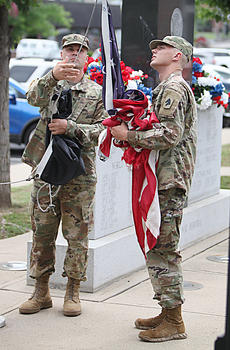 "<div class=""source"">photo/JEFF MORELAND</div><div class=""image-desc"">U.S. Army soldiers Staff Sergeant Jonathan Hutchens, left, and Private First Class Jordan Pratt lower the old American flag and prepare to raise a new one during Monday's community Memorial Day celebration at the Taylor County War Memorial.</div><div class=""buy-pic""><a href=""/photo_select/67093"">Buy this photo</a></div>"