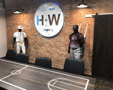 """<div class=""""source"""">Jeff Moreland</div><div class=""""image-desc"""">H&W Sport Shop's new location features a conference room with a table designed to look like a basketball court. </div><div class=""""buy-pic""""><a href=""""/photo_select/66678"""">Buy this photo</a></div>"""