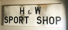 """<div class=""""source"""">Jeff Moreland</div><div class=""""image-desc"""">This sign located in the new building is one piece of historical memorabilia located in the H&W Sport Shop</div><div class=""""buy-pic""""><a href=""""/photo_select/66679"""">Buy this photo</a></div>"""