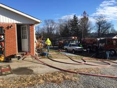 "<div class=""source"">Campbellsville Fire-Rescue</div><div class=""image-desc"">Firefighters were able to rescue a mother and child from a house fire on Candace Street Monday morning. </div><div class=""buy-pic""></div>"