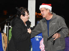 "<div class=""source"">Zac Oakes</div><div class=""image-desc"">Ricky Malone (right) was honored with this year's Santa's Helper Award from the Campbellsville Kiwanis Club at the Christmas Lighting Ceremony at Miller Park. He is pictured with Patricia Sprowles. </div><div class=""buy-pic""><a href=""/photo_select/66345"">Buy this photo</a></div>"