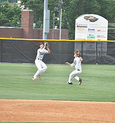 "<div class=""source"">photo/JOSH CLAYWELL</div><div class=""image-desc"">Taylor County's Grant McQueary and Griffin Hall both attempt to catch a fly ball Monday against Adair County. McQueary made the catch, avoiding a collision with Hall.</div><div class=""buy-pic""><a href=""/photo_select/67041"">Buy this photo</a></div>"