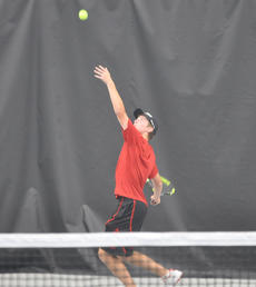 "<div class=""source"">photo/JOSH CLAYWELL</div><div class=""image-desc"">Taylor County's Cooper Parks serves during a match against Elizabethtown in the first round of the KHSAA State Tennis Championships at the Top Seed Tennis Center in Nicholasville.</div><div class=""buy-pic""><a href=""/photo_select/67034"">Buy this photo</a></div>"