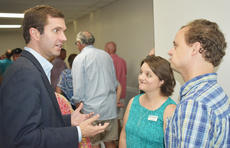 """<div class=""""source"""">Photo/Zac Oakes</div><div class=""""image-desc"""">Kentucky Attorney General and 2019 Kentucky Governor candidate Andy Beshear speaks with Campbellsville-Taylor County Chamber of Commerce Director Niki Marineau and her husband, Josiah, a political science professor at Campbellsville University.</div><div class=""""buy-pic""""><a href=""""/photo_select/67349"""">Buy this photo</a></div>"""