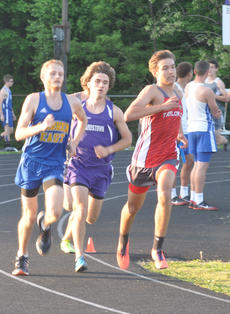 "<div class=""source"">Josh Claywell</div><div class=""image-desc"">Taylor County's Ryan Maynard runs in the 1,600-meter run Tuesday in the Class 2-A, Region 2 championship meet at Bardstown High School.</div><div class=""buy-pic""><a href=""/photo_select/66935"">Buy this photo</a></div>"